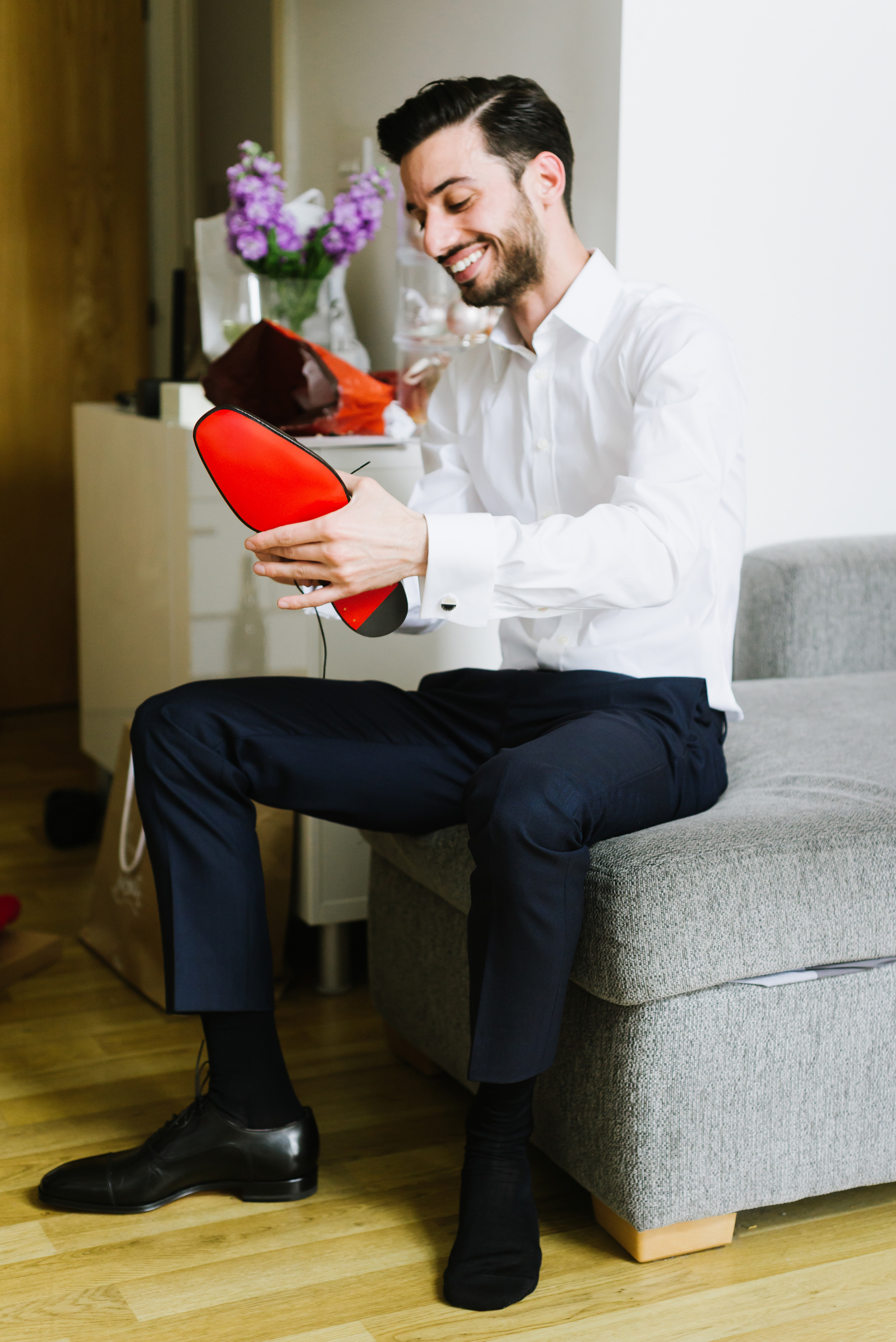 groom wearing mens black louboutain shoes red sole