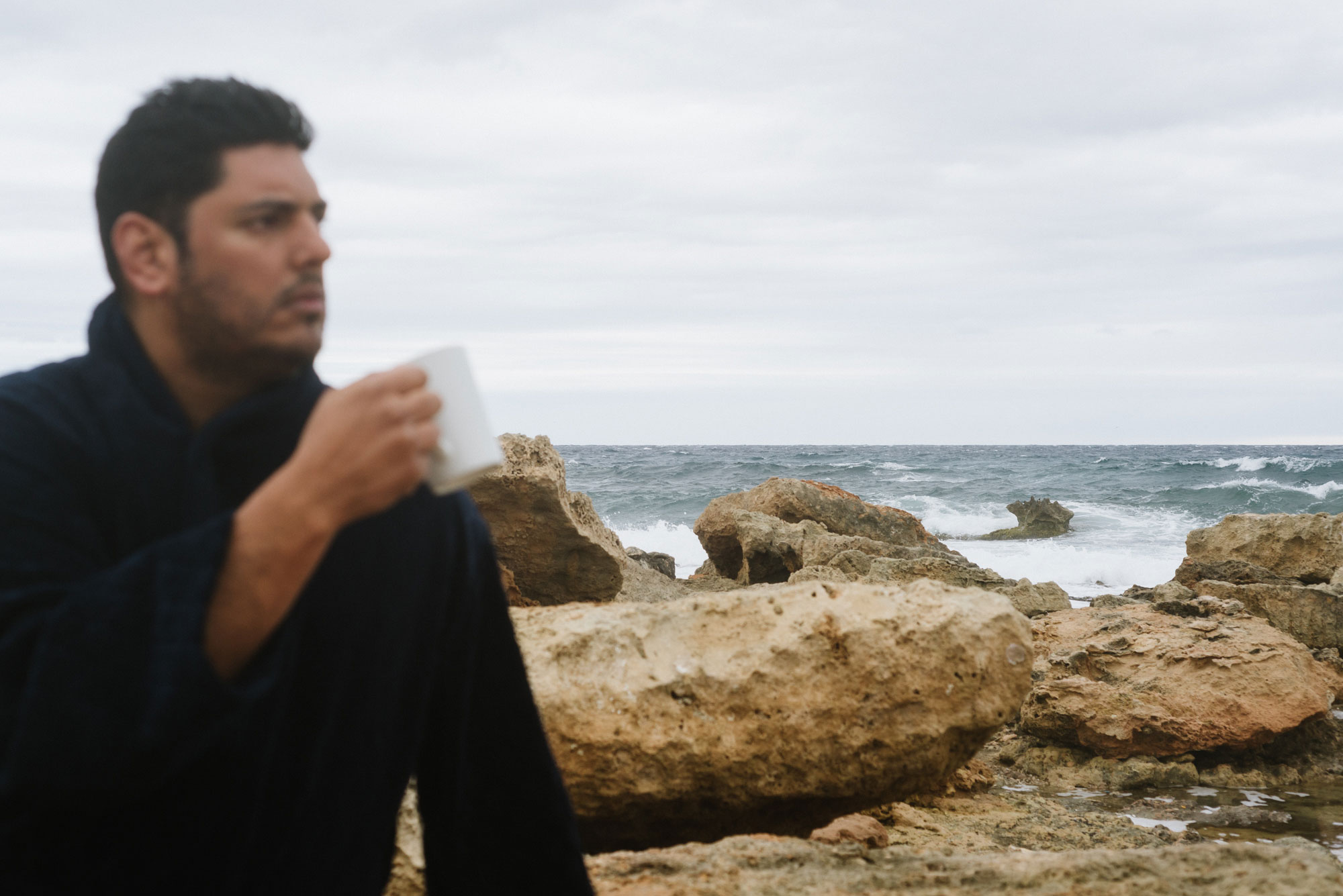 Wedding Photographer In Ibiza Wears Velour Dressing Gown, Takes Deep Breath & Sips Coffee On The Beach