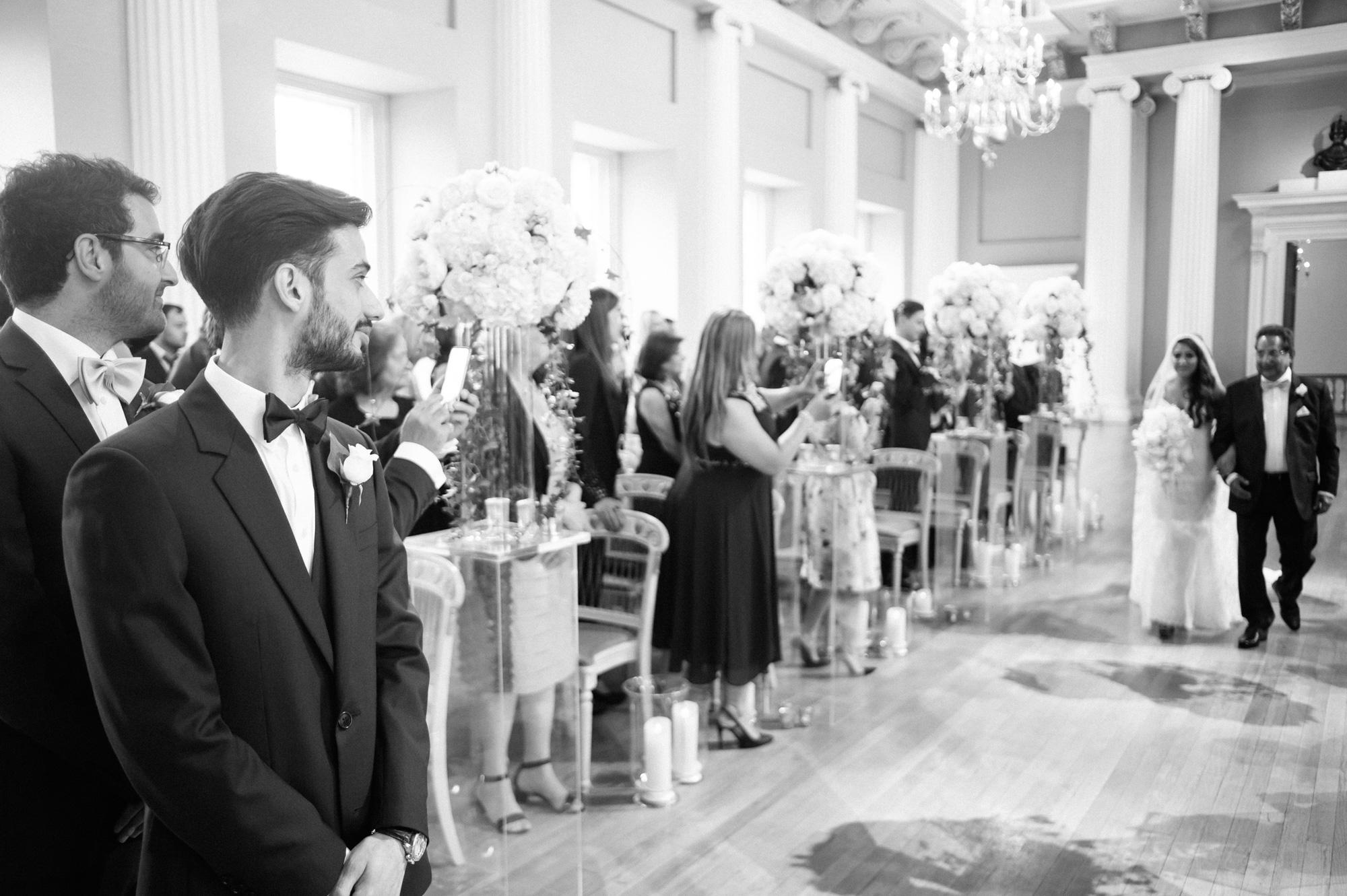 bride walking down aisle at banqueting house london wedding