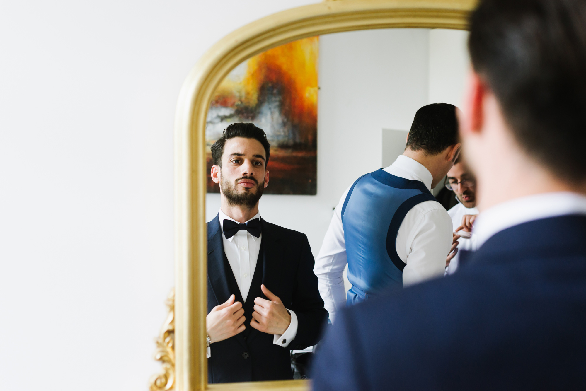 groom wearing dior suit getting ready for wedding