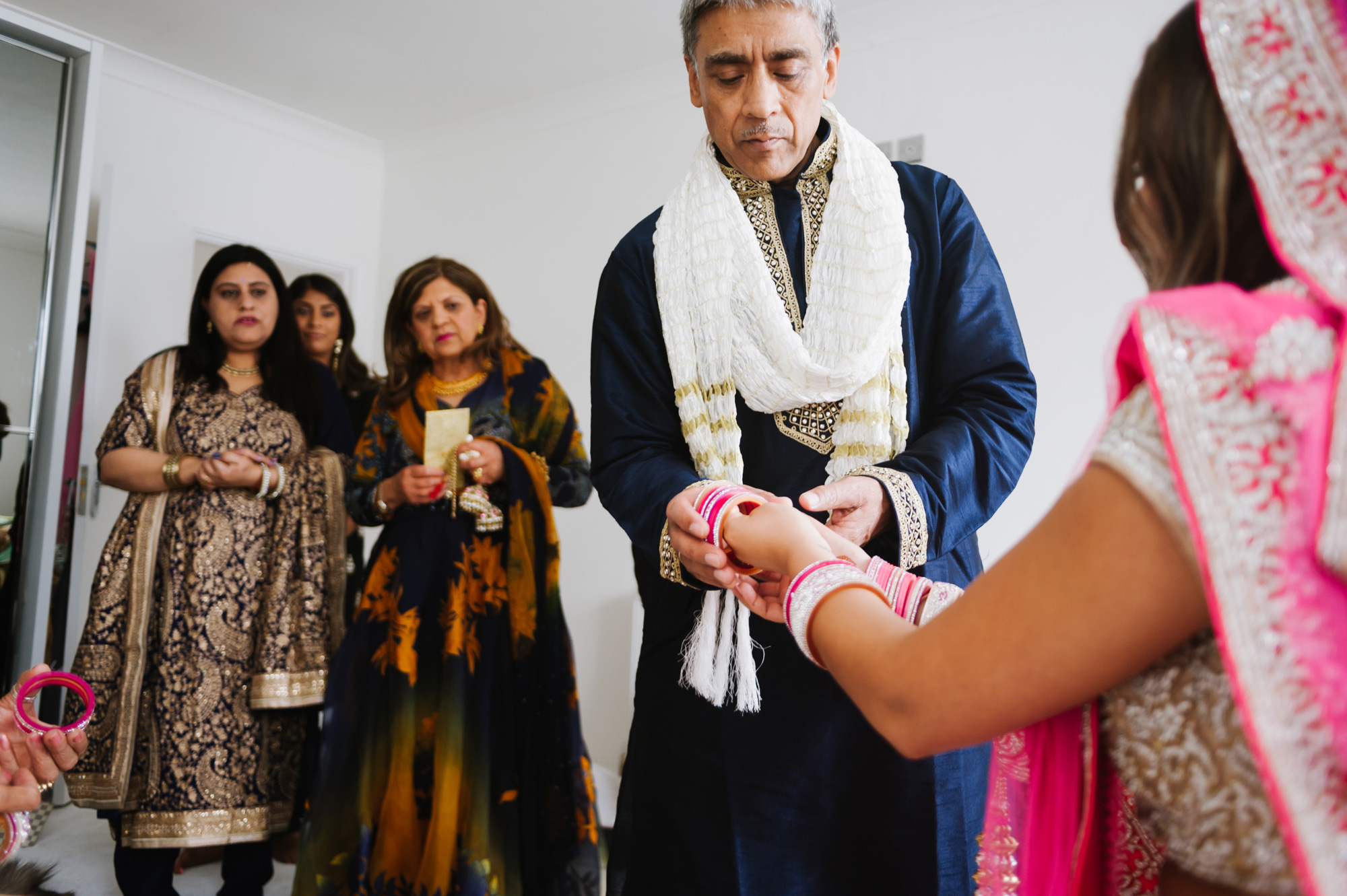 Bride putting on Bangles Indian Wedding Solihull