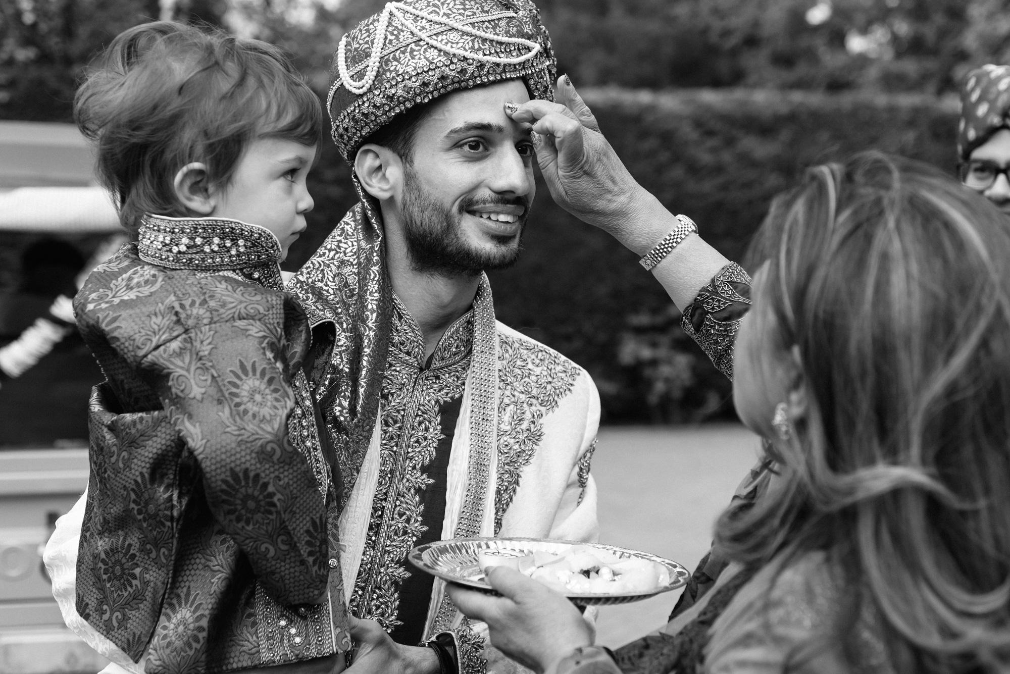 Groom arriving indian wedding solihull