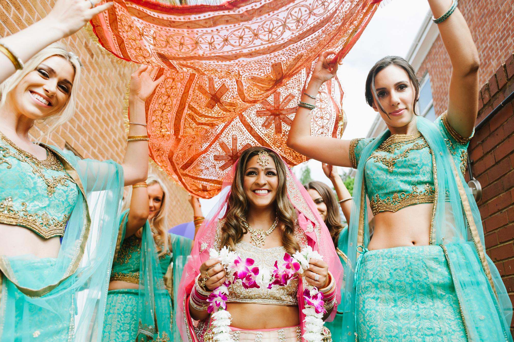 indian wedding bride with bridesmaids entrance